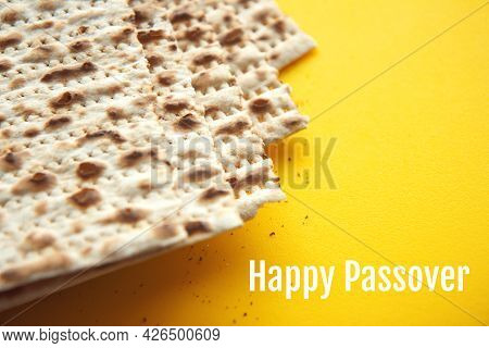 Traditional Jewish Kosher Matzo For Passover. Set With Passover Matzos On Yellow Background. Pesach