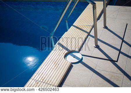 Closeup Beautiful Image Of Metal Stairs In The Swimming Pool
