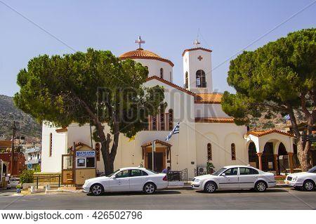Malia, Greece - July, 02, 2021: Malia Main Church Agios Nektarios. Cathedral Of The Orthodox Church