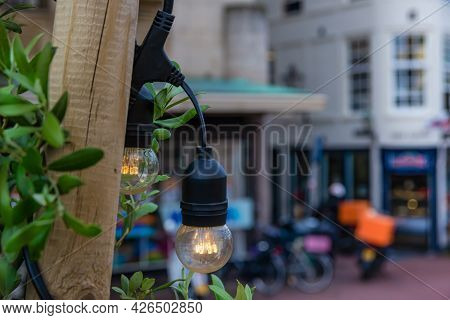 Light Bulbs Hanging From The Wooden Posts, Streets Of Leiden, Netherlands