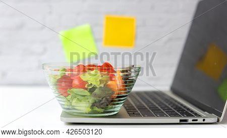 Healthy Working In Office.  Fresh Vegetable Salad With Water For Diet Health Plan With Laptop On Whi