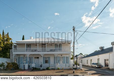 Prince Albert, South Africa - April 20, 2021: A Street Scene, With Historic Buildings, In Prince Alb