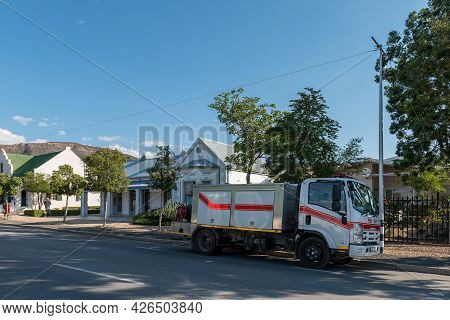 Prince Albert, South Africa - April 20, 2021: A Street Scene, With An Art Gallery And A Fire Truck,