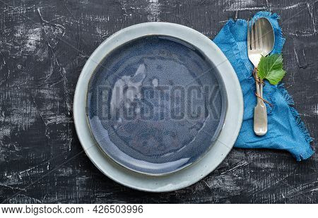 Empty Blue Plate Served With Fork Spoon Grape Leaf Plant Table Napkin. Mockup Template Plate For Lux