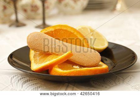 Ladyfinger biscuit and orange