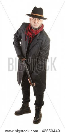 Bearded man with hat and shotgun