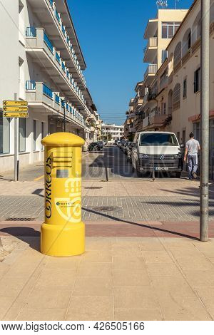 Colonia De Sant Jordi, Spain; July 02 2021: Yellow Mailbox Of The Spanish Postal And Telegraph Compa