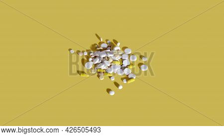 Pile Of Assorted Capsules And Pills On Yellow Background. Health And Pharmaceutical Industry Concept