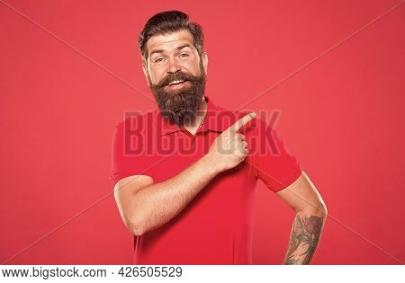 Promoting Barber Services. Portrait Of Bearded Man Red Background. Brutal Guy With Mustache. Guy Wit