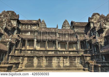 An Ancient Temple In The Famous Angkor. Stone Building With Galleries And Colonnades. There Are High