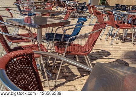 Terrace Of A Restaurant With Empty Tables And Chairs Due To The Economic Crisis Resulting From The C