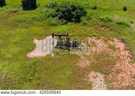 View Aerial Pump Jack In A Canola Field In Oklahoma An Oil Well Pump Jack Pumping Crude Oil Fuels