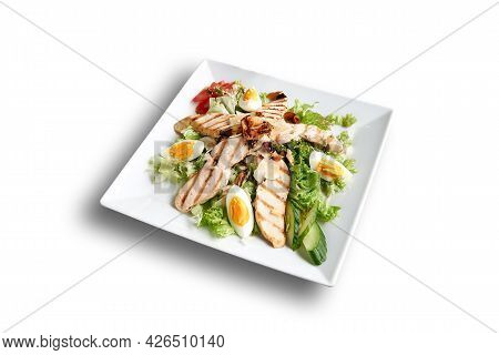 White Plate With Caesar Salad Isolated On White
