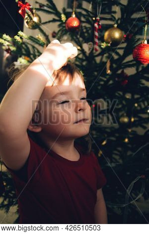 Portrait Of A Child Enjoying The Sun On Christmas Weekend