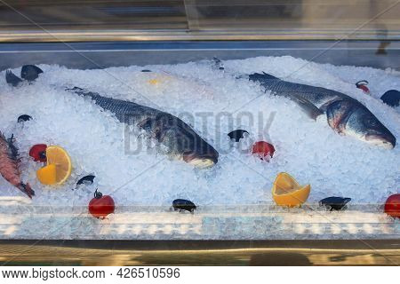 Fresh Fish And Seafood In Ice Near The Restaurant.