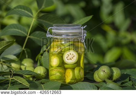 Sliced Unripe Walnuts In Alcohol In A Jar, To Prepare Homemade Tincture, Close Up. Tincture Of Green