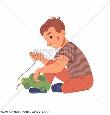 Active Boy Kid Playing With Plastic Car Toy, Isolated Kiddo From Kindergarten Or Preschool Education