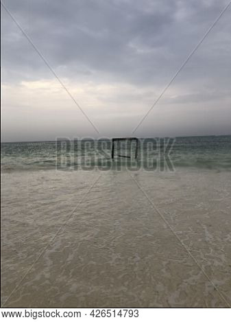 Indian Ocean Coast. Wooden Swing In The Ebb And Flow. Zanzibar Island. Africa. Typical View.