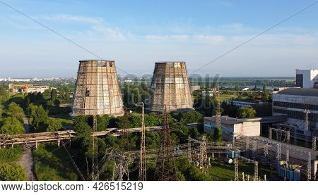 Aerial Drone View Flight Near Thermal Power Plant. Cooling Towers Of Chp