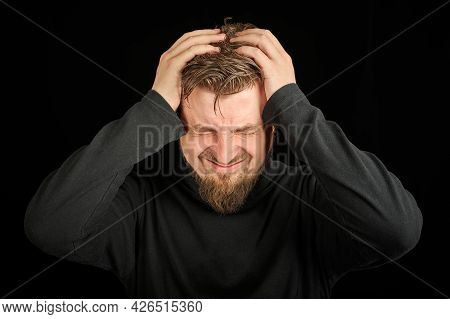 Exhausted Bearded Man Portrait With Headache, Black Background. Overworking, Head Pain Concept. Youn
