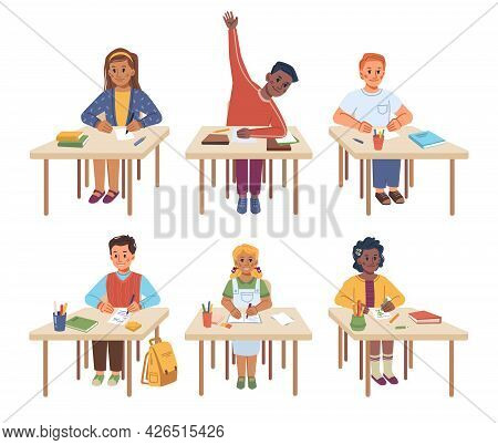 Children Studying In School Sitting By Desks At Lesson. Isolated Kids Writing Down Information And A
