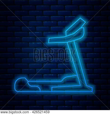 Glowing Neon Line Treadmill Machine Icon Isolated On Brick Wall Background. Vector