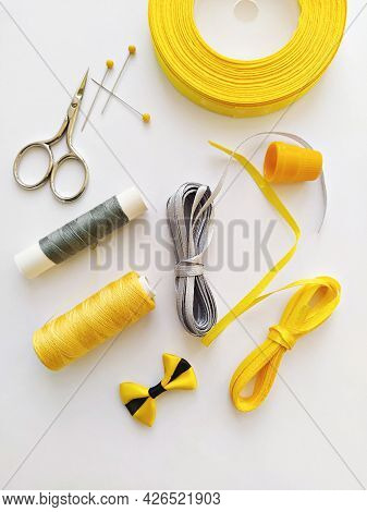 Flat Lay With Sewing Kit And Sewing Accessories In Trend Illuminating Yellow And Ultimate Gray Ribbo