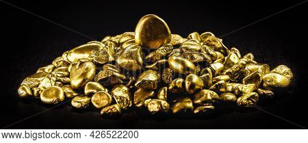 Various Gold Nuggets On Isolated Black Background.