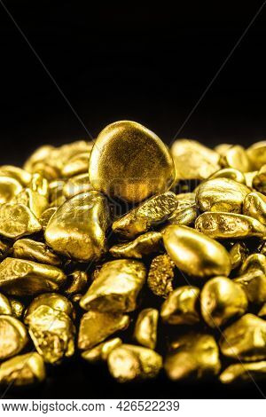 Many Gold Nuggets On Isolated Black Background, Concept Of Wealth And Rare Ores
