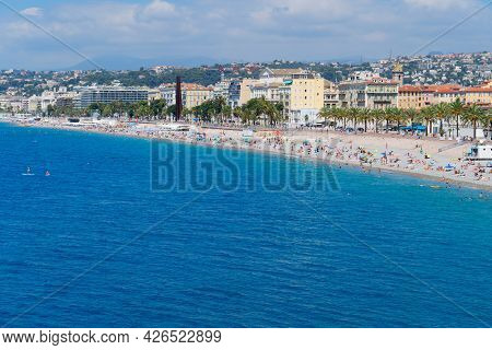 Beach And Turquiose Water Of Cote Dazur Coast, Nice Waterfront, Riviera, France