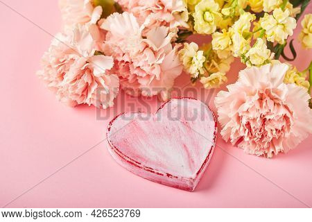 Bouquet Of Pink Carnations And Yellow Matthiola With Decorative Heart. Design Concept Of Holiday Gre