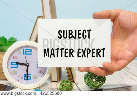Subject Matter Expert - Text On A Card In Your Hand Next To Office Supplies