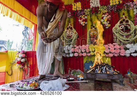 Howrah, West Bengal, India - 29th June 2020 : Hindu Purohit, Priest Distributing Prasad, After Worsh