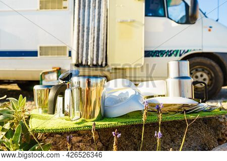Many Clean Dishes Outdoor On Dish Drying Mat Against Camper Vehicle. Washing Up On Fresh Air. Campin