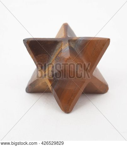 A Wooden Mercaba Photographed Against A White Background