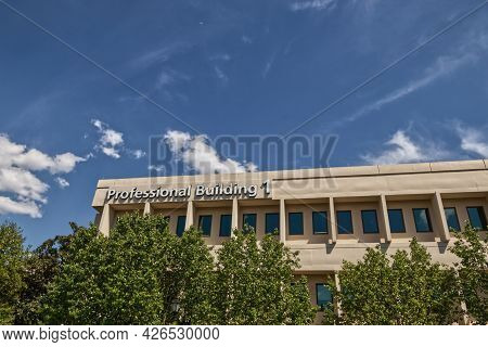 A Professional Building Complex Exterior Partial Building And Sign View
