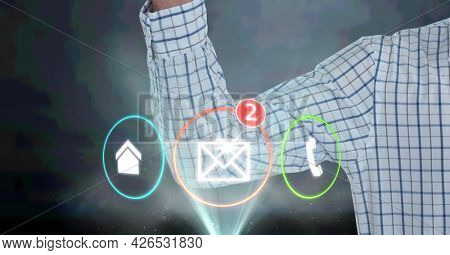 Composition of digital icons over midsection of businessman. global business, digital interface, technology and networking concept digitally generated image.