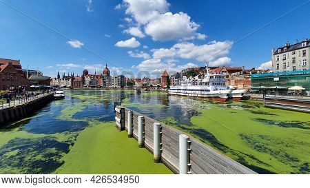 Gdansk, Poland - July 11, 2021: View Of The Old City Of Gdansk On The Motlawa River. Tourists Walk A