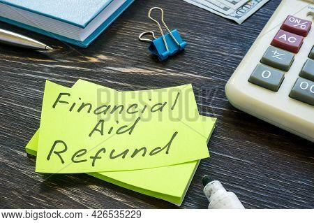 Financial Aid Refund Handwritten On The Sticker And Marker.