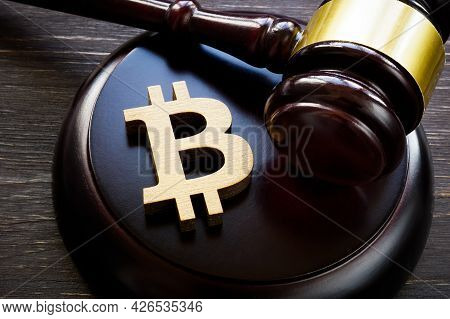 Bitcoin Symbol And Gavel To Regulate Cryptocurrencies Market.