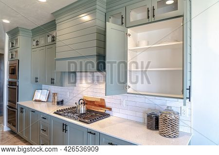 Kitchen Interior With Wood Cabinets Exhaust Hood Cooking Appliances And Cooktop