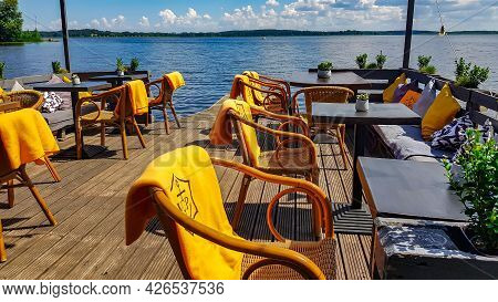 Latvia, Riga, July, 2021 - An Open Veranda Of A Summer Cafe On The Shore Kisezers Lake - One Of The