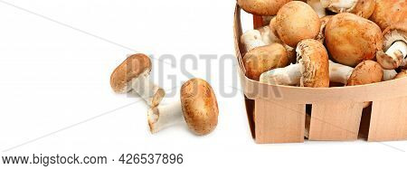 Fresh Champignons In A Basket Isolated On White Background. There Is Free Space For Text. Wide Photo