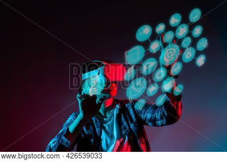 Caucasian Woman 35-40 Years In Vr Glasses, Using Virtual Reality Headset, Trying To Touch Something