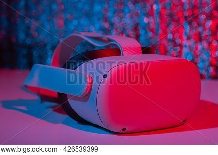 Virtual Reality Helmet On White Background In Neon Light. Vr, Future, Gadgets, Technology Concept.