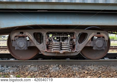 Close-up Of Wheelset On Railway Tracks. A Wheelset Is The Wheel-axle Assembly Of A Railroad Car