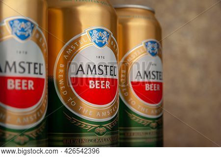 Beer Cans. Amstel Beer In Cans Close-up On An Abstract Background. An Internationally Renowned Brand