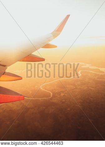 Hazy Airplane Wing View Sunny Cinematic Panorama During Flight Over Land Copy Paste Vertical Backgro