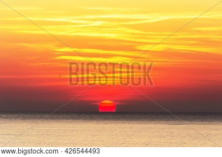 A Breathtaking View Of The Picturesque Yellow-red Sunrise Over The Sea. Bright Yellow-red Sky, Red S