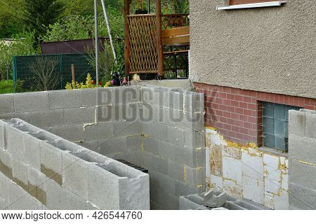 Extension Of The Walls Of Prefabricated Blocks To The Existing Cottage
